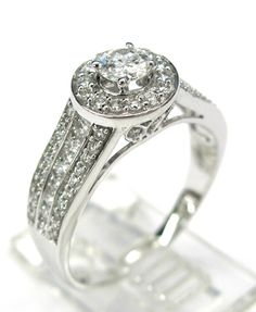 Ladies 14kt white gold engagement ring. Engagement ring contains 1 brilliant round cut center diamond and 74 brilliant round cut diamonds weighing approximately 1.10ct. Diamonds are SI1 clarity H-I color.