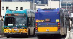 Two King County Metro 2012 New Flyer DE60LFRs pass each other on the SODO Busway