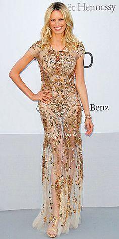 Karolina Kurkova in sheer embellished gilded gown at Cannes Film Festival
