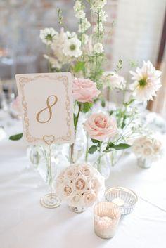 Baby Pink & White Flower Stem Centre Pieces | Pronovias Wedding Dress | Pastel Pink Colour Scheme | Rustic Barn | Almonry Barn Wedding Venue | Images By Julie Michaelsen | http://www.rockmywedding.co.uk/kat-alex/