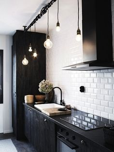 A black kitchen with white subway tiles looks slick.