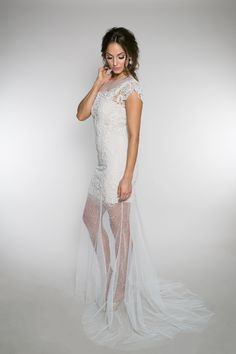 {Evelyn Faith} This sheath wedding gown is covered in hand beaded pearls. It is worn over a stretch charmeuse slip and has a ribbon tie at the neck. | Bride | Wedding | Wedding Dress | Wedding Gown | Engaged | Pretty Wedding | Classic |