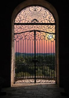 beautiful Mediterranean sunset thru lovely iron gates
