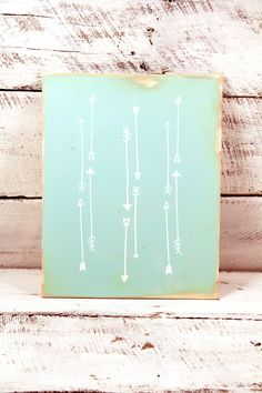 Wooden teal blue arrow indian screen print on distressed wood