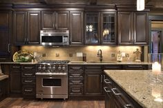 Love everything about this kitchen! Cabinet color, granited, wood floors