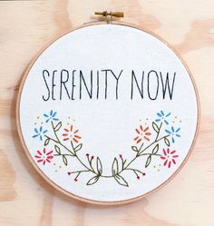 Serenity Now Hand embroidered Seinfeld quote hoop art to cheer up your empty room. Details: - High quality organic cotton stretched over an 6""
