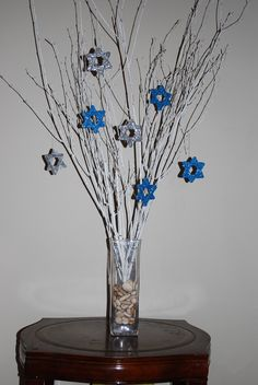 Craft-sticks, glitter and glue:  http://kids.baristanet.com/2010/11/ask-holly-hanukkah-napkin-rings-and-centerpiece/
