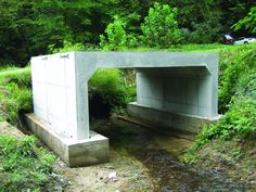 Installed quickly with less labor, maintenance-free precast concrete box culvert bridges deliver a long service life. Concrete Molds, Precast Concrete, Concrete Houses, Driveway Culvert, Driveway Landscaping, Corrugated Metal Pipe, Shipping Container Pool, General Construction, Bridge Construction
