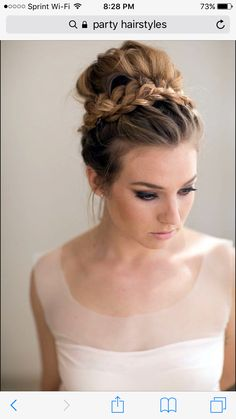 A cute bun with a braid around. perfect for a summer party!