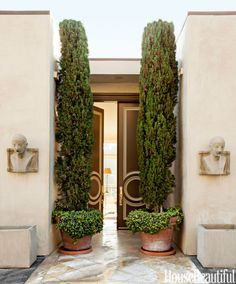 The grand double front doors in Alex Hitz's Beverly Hills, California, house are an homage to Hollywood Regency architect John Woolf.   - HouseBeautiful.com