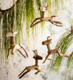 Driftwood reindeer ornament. Leaping driftwood reindeer hang from the Christmas tree. Created using reclaimed driftwood.