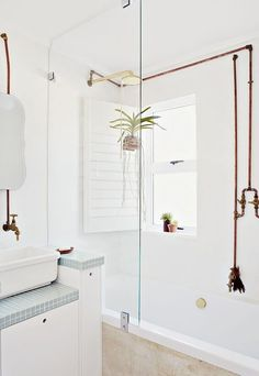 I love the exposed piping, this would be cool in the bathroom remodel (and make it easier to do the work)