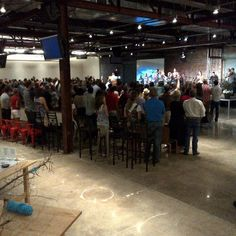Ecclesia Church, Houston. This image illustrates another unifying value among modern worship set designs, ie the presence of industrial elements like polished concrete floors and brick stage backgrounds, and blacked out industrial ceilings.