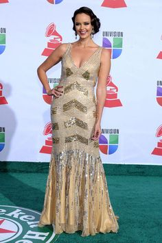 Latin Singer, Shaila Durcall radiated elegance and beauty in SCALA by ASHLEYlauren style SA1011 in Gold. This dress earned her top 5 best dressed in People Espanol Magazine!  Watch Shaila's interview on the green carpet here: http://youtu.be/UgrIzms8zxs