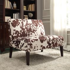 @Overstock.com - Brown Cow Hide Fabric 2-seater Accent Loveseat - This attractive cow-hide fabric loveseat has a distinctive look that will look great in any living room. Its wood frame ensures it's durable enough for daily use, and its white and espresso upholstery works perfectly in a natural color scheme.  http://www.overstock.com/Home-Garden/Brown-Cow-Hide-Fabric-2-seater-Accent-Loveseat/8060342/product.html?CID=214117 $316.99