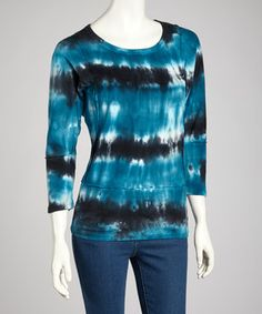Artfully crafted for the laid-back fashion maven seeking comfort and style, this tie-dye top blends a pure cotton construction with an eye-catching design.