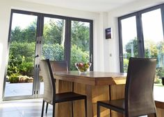 Sliding and stacking patio door / aluminum / double-glazed - BI-FOLDING - Apropos Tectonic Limited Garden Room Extensions, House Extensions, Kitchen Extensions, Sliding Patio Doors, Folding Doors, Glass And Aluminium, Conservatory, New Homes, Extension Ideas