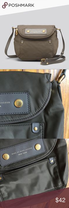 "Marc Jacobs Preppy Nylon Mini Natasha Cement Gray Amazing Mini Natasha bag, only worn a handful of time. Overall great condition with a few specific marks I displayed in photos - a ""graze"" on the front, difficult to see but check last photo. There is one tiny dark spot on the back left near the bottom, and the very edge of the strap loop has a peel, would be easy to fix. Love it, just needed the large one!  It's seriously THE best travel bag, excellent storage and safety pocket for…"