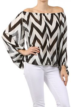 One of the most stylish blouses out there!  Amazing chevron print is gorgeous in either mocha/black or white/black.  This is a top that you can wear so many ways! Dress it up with a pair of trousers, a pencil skirt, or wear it casual with your favorite jeans!  Elastic at the cuff makes the sleeve blouse and loose fitting.