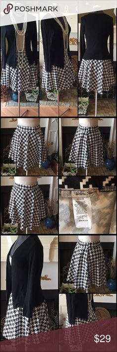 Super Cute Houndstooth Skater Skirt Absolutely adorable black and white houndstooth skirt with elastic waist. Very comfortable and almost new. Great condition. Size is XL but fits me and I'm a medium. Ultra Teeze Skirts Mini