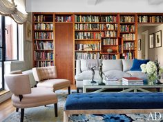 a pair of Duane Modern slipper chairs upholstered in a Holland & Sherry linen join a 1970s chrome bench in a Glant chenille plus a Roman Thomas sofa in a Rogers & Goffigon linen. The bronze nudes are by Harriet W. Frishmuth, and the vintage Danish floor lamps are from Dienst + Dotter Antikviteter.  DESIGNER: Robert Couturier Inc. PHOTOGRAPHER: Joshua McHugh