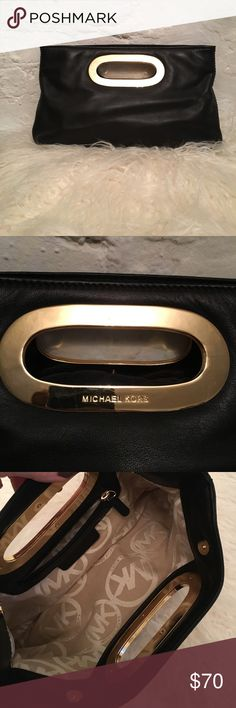"Michael Kors black leather clutch Never carried Michael Kors black leather clutch. Gold hardware and handle with magnetic snaps. Some slight scratches and wear from storage - tried to show in pics. Beautiful and soft leather exterior with zipper pocket inside. Approx dimensions 12"" x 8"". Michael Kors Bags Clutches & Wristlets"