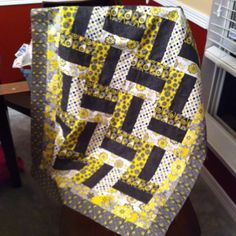 Yellow and black quilt I made