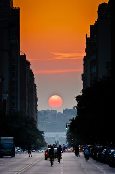 "Twice a year, New Yorkers get a chance to experience ""Manhattanhenge"", the occurrence where the setting sun aligns perfectly with east-west streets. - spectacular!"