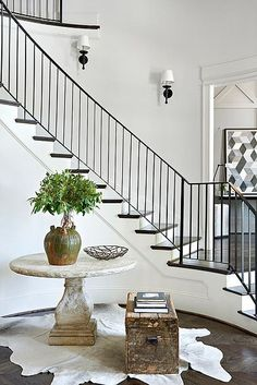 simple iron stair railing with white alls and mouldings | desire to inspire