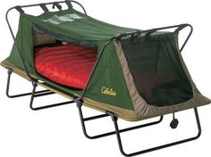 I might actually go camping now. Does it have a plug-in for my curling iron?  Cabela's: Cabela's Deluxe Tent Cot