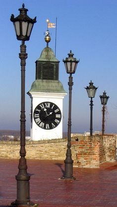 Clock tower and lamps - Novi Sad, Vojvodina, Serbia. This clock is different. The big hand shows the hour and the small hand the minutes. Montenegro, Albania, Bosnia Y Herzegovina, Most Beautiful Pictures, Beautiful Places, Bulgaria, Cool Clocks, Big Clocks, Novi Sad
