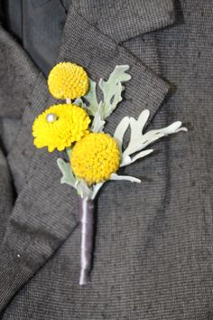 Yellow button chrysanthemum with pearls, dusty miller boutonniere. Great with a grey suit. Created by Dianne, from Emerald Iris Florals Wisconsin.