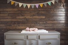 Baby Violet and Her Boho Nursery - Dad made the wooden wall and mom made the cute bunting.