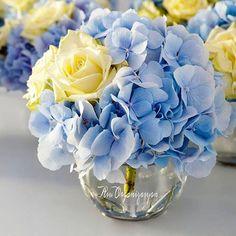 Hydrangeas & roses wedding centerpiece.                                                                                                                                                     More