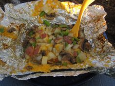 Hobo (campfire food): We start with a base of ground beef and potatoes, then pile on the veggies. I like onion, bell pepper, and mushrooms!