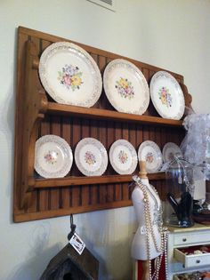 Vintage plates and the plate holder are both for sale at DeeDees.