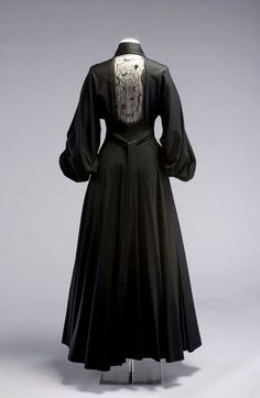 Image: Full-skirted evening dress with long 'bishop's' sleeves and broad shirt…