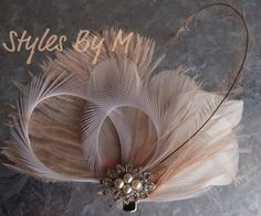 Beautiful bride or bridesmaid pc feather fascinator in creams whites and its amazing!