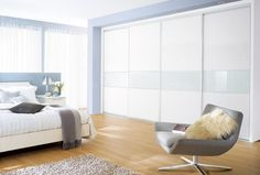 From http://www.sharps.co.uk/bedroom-furniture/wardrobes/custom-made-wardrobes/ - Sliding doors, available UK