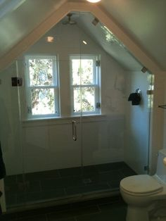 Angled ceiling with shower door..... Except all the neighbors could see me ...
