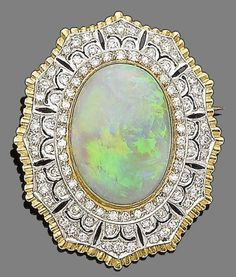 An opal and diamond brooch/pendant Designed as a radiating starburst, set to the centre with an oval cabochon opal, within a pierced surround of brilliant-cut diamonds, diamonds approx. 1.50cts total, length 4.3cm, fitted case
