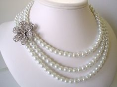 Three Strand Large Rhinestone Flower Pendant with White Pearls Beaded Necklace Set Great for the Bride. $40.00, via Etsy.