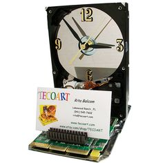 Business Card Holder Hard Drive Clock from Recycled Hard Drive. Awesome recycle and conversation piece!
