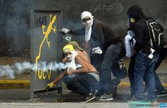 Protestors clash with riot police in Caracas, Venezuela, 12-03-2014