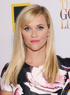 Reese Witherspoon with straight hair, bright pink lips and thick lashes on September 17.