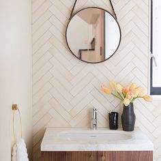We love all the materials used in this beautiful bathroom. This is a custom white in a herringbone pattern, for a look similar to this you could try our Ultra Cream, Tusk or Gardenia. Designer: Stellah Deville