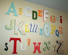 I have been looking at this idea for awhile...I love it! Have each person sign the back with a message too-take a picture as they walk in with their letter so you can make a alphabet book from Shutterfly starring family and friends!