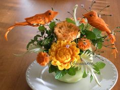 Lovebirds Bouquet    This lovely bouquet arrangement was carve with carrot, yam, butternut squash and cabbage leaves rearrange on a winter squash ideal for holiday table decoration.