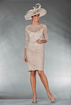 Mother Of The Bride / Groom Outfit: Knee length cream lace dress with sheer sleeves.Like without the hat.