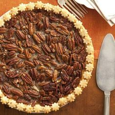 Brown sugar- and maple syrup-drenched pecans are the sweet and sticky filling for this perfect holiday pie.